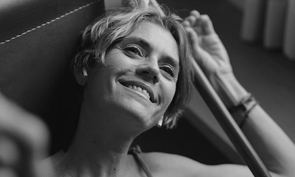 black and white photo of content woman lying down and smiling